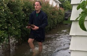 Brennan Fell outside his flooded Mt Albert house.