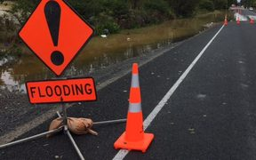 Mill Road in Takanini is closed due to flooding.