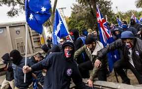 Protestors wear face masks during a 'Say No To Racism' protest in Coburg, Melbourne last year.