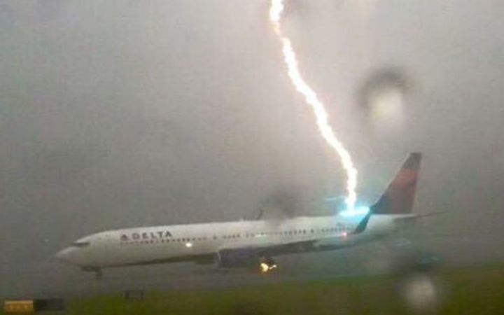 A plane being hit by lightning while on the tarmac the Atlanta Hartsfield Airport, Georgia, United States in 2015.