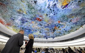 Delegates speaks prior to the opening of a session of the Human Rights Council on the Palestinian territories situation on March 23, 2015 in Geneva.