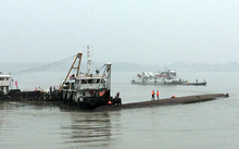 Rescue boats can be seen alongside the capsized passenger ship in the Yangtze.