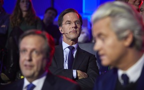 Netherland's Prime Minister Mark Rutte sits behind Alexander Pechtold of Dutch Democratic 66, left, and eert Wilders of the Freedom Party, right, ahead of a televised election debate.