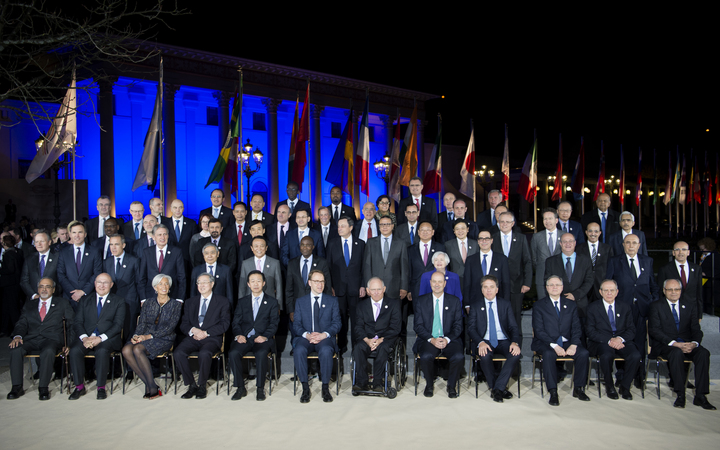 G20 finance ministers and central bankers take a group photo at the 2017 meeting in Baden Baden, Germany.