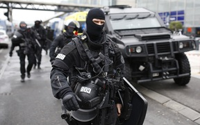 RAID police unit officers secure the area at the Paris' Orly airport on 18 March, 2017 following the shooting of a man by French security forces.