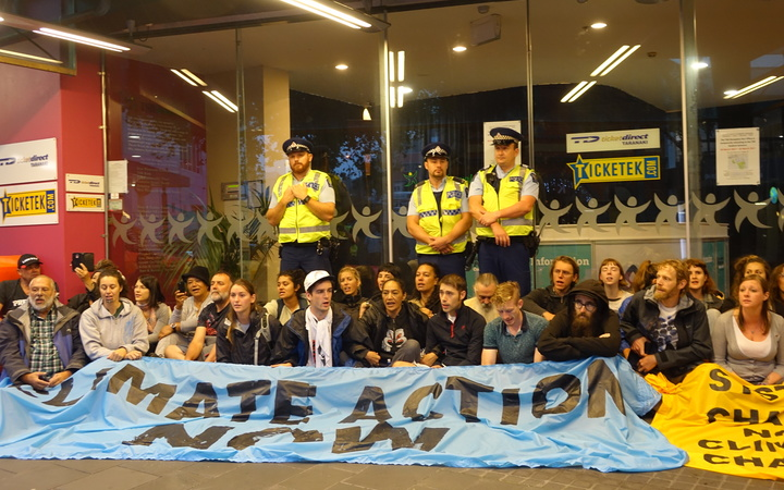 Protesters block the entrance to the TSB Showplace, New Plymouth, where the NZ Petroleum Conference is being held.