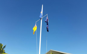 Niue and New Zea land flags raised outside the fono.
