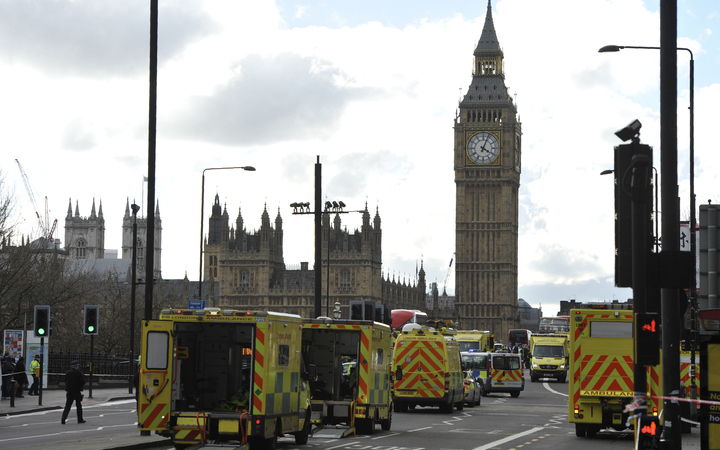 Members of the emergency services work to help victms on Westminster Bridge.