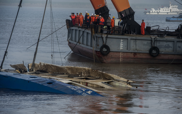 Chinese salvagers have begun to right an upturned ship on which more than 400 people are thought to have died.