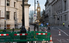 Police take security measures near Parliament square in Westminster, London after a man drove through pedestrians and stabbed a police officer.