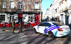 A police car blocks access to De Meir, Antwerp's main pedestrian street, after a man was arrested after he tried to drive into a crowd of shoppers at high speed on the street, on March 23, 2017, in Antwerp.