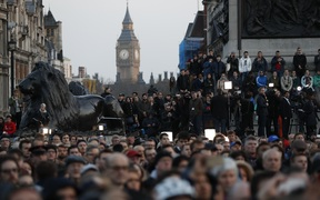 People gather for a vigil in Trafalgar Square in central London on March 23, 2017 in solidarity with the victims of the March 22 terror attack at the British parliament and on Westminster Bridge. Britain's parliament reopened on Thursday with a minute's silence in a gesture of defiance.