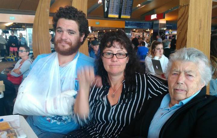 Stranded passenger Vickie Davis, centre, with fellow Air New Zealand passengers initially offered only a pillow and blanket. Named on social media as Augustus Whanga, left, and Gillian Finnegan, 84, right.