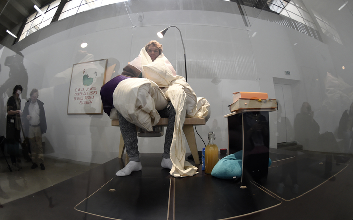 French artist Abraham Poincheval incubates eggs at the Palais de Tokyo musuem in Paris.