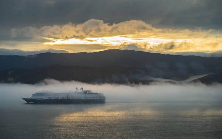 A ship sails through fog in Wellington Harbour on Wednesday.
