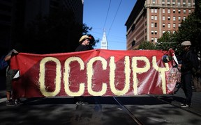 Occupy Wall Street protestors hold a large banner during a demonstration in San Francisco in 2012.