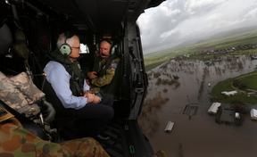 Australian Prime Minister Malcolm Turnbull surveys flooding in Queensland in the aftermath of Cyclone Debbie.