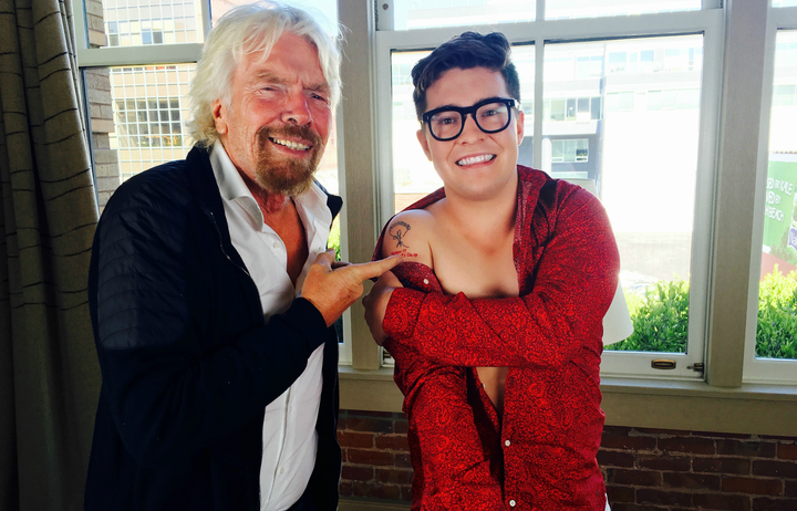"Jake Millar shows Richard Branson his tattoo. ""The tattoo is a replica of a parachute my late father drew on my 10th birthday card. Underneath the parachute, it says 'Screw It, Let's Do It,' which is one of Richard's main quotes."""