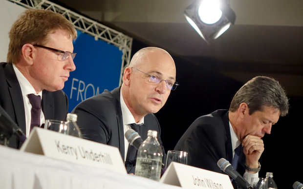 Fonterra chief executive Theo Spierings announces a large profit fall with chairman John Wilson, left, and chief financial officer Lukas Paravicini, right.