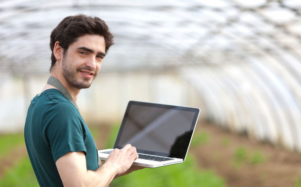 young farmer with laptop