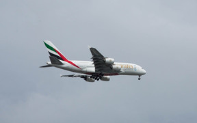 Emirates plane flying into the Auckland International Airport