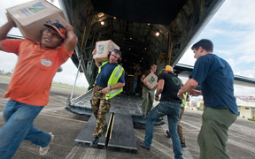 Aid is unloaded from a C-130 Hercules.