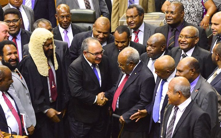 Sir Michael Somare (with walking stick) is congratulated by Peter O'Neill and other MPs on his last attendance in Papua New Guinea's parliament, 4 April 2017.