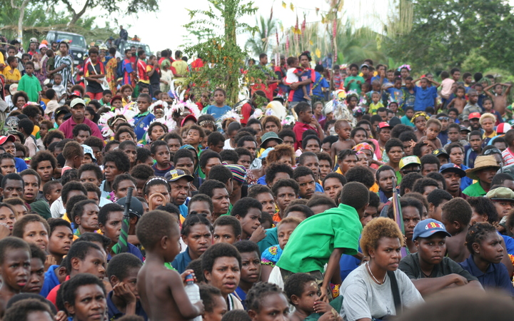 When he speaks, people listen: Papua New Guineans attend a campaign rally  held by Papua New Guinea's longest serving prime minister Michael Somare.