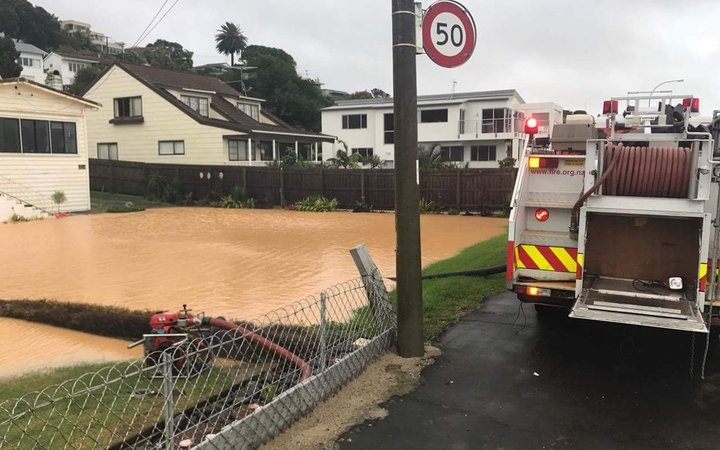 Fire crews at flooded properties on Maraetai Drive, Beachlands, Auckland.
