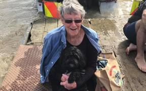 Ursula Mayo and her dog Poppy were rescued from floodwaters by Mrs Mayo's son-in-law Tautini Hahipene.