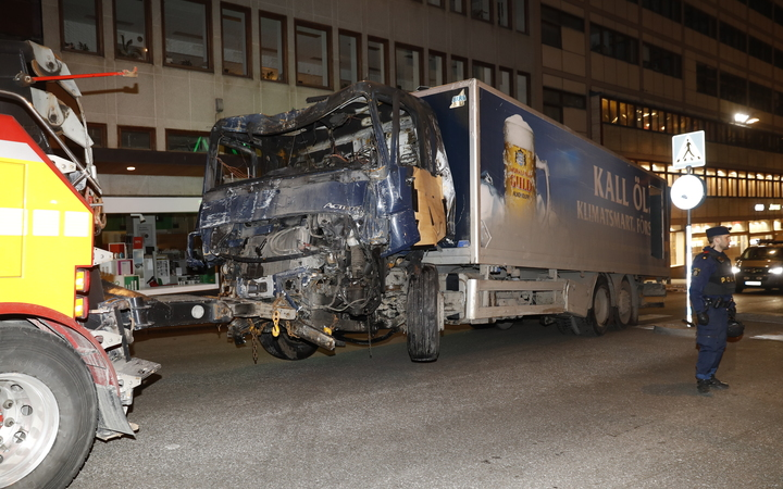 The stolen truck, which was driven through a crowd outside a department in Stockholm on April 7, 2017, is removed from the area.