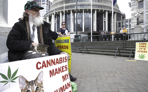Members of Parliaments, lobists and supports gathered outside Parliament with petition to legalise cannabis, 17,000 people signed the petition. Gary Chiles with his cat Tiffany.
