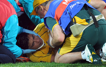 Wallabies player Anthony Faingaa is rolled onto a stretcher after receiving an accidental knee to the head during the 2011 Rugby World Cup.