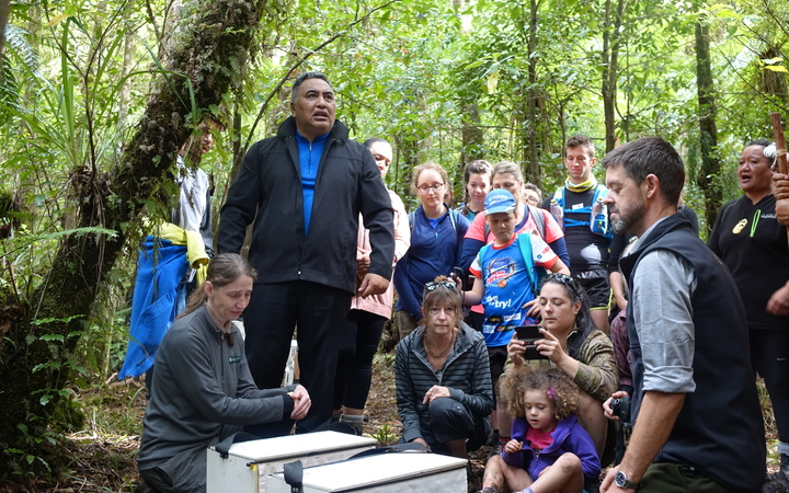 Ngāti Rereahu iwi member Tutahanga Tepu blesses the first robin before they are released.