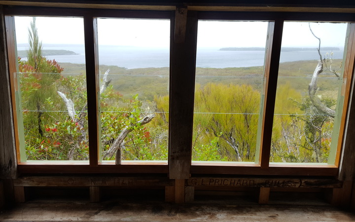 View of Port Ross from the window of the Coastwatcher's lookout at Ranui Cove