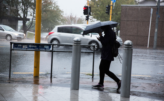 Rain pours down in the Auckland CBD.