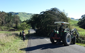 Farmers out clearing the road on Kahuranaki Road in Tukituki Valley, Hawke's Bay.