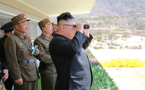 "This undated picture released from North Korea's official Korean Central News Agency (KCNA) on April 14, 2017 shows North Korean leader Kim Jong-Un (C) inspecting the ""Dropping and Target-striking Contest of KPA Special Operation Forces - 2017"" at an undisclosed location in North Korea."