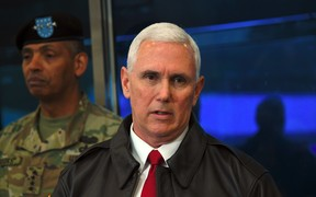 Mike Pence (right) speaks to the media as US General Vincent Brooks, Commander of the United Nations Command, Combined Forces Command and United States Forces Korea looks on.