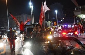 Supporters of Turkish President Tayyip Erdogan celebrate victory in the Turkey's constitutional referendum.