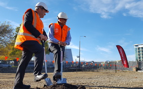 Fletcher Building CEO Steve Evans (left) and Otakaro ltd CEO Albert Brantley (right) breaking the ground on the construction site.