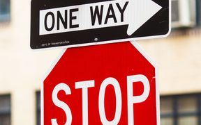 One way and stop signs