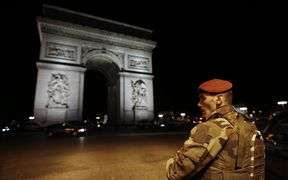 A soldier stand guards near the Arc de Triomphe after a shooting at the Champs Elysees in Paris on April 20, 2017.