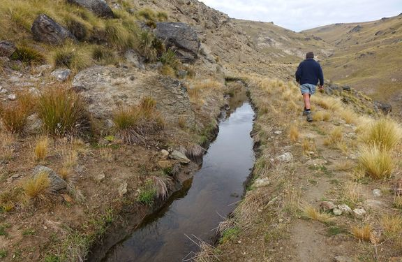 Water channel dug into Otago hillside