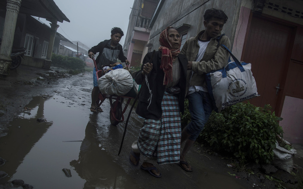 Villagers leave their homes to a safer area as local government evacuate people who live close to Mount Sinabung.