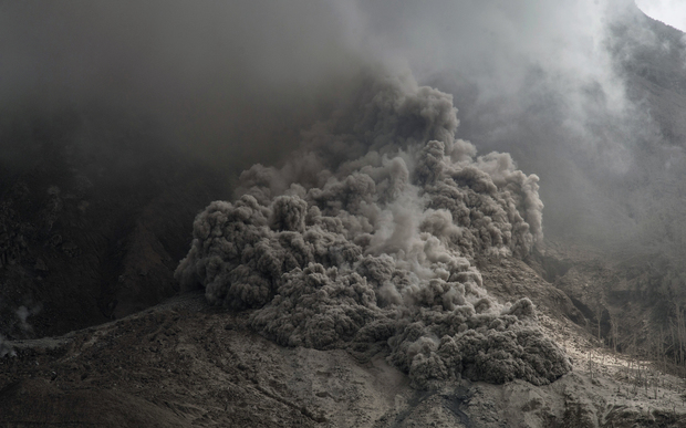 Volcanic ash spews from the mountain on 14 June 2015.