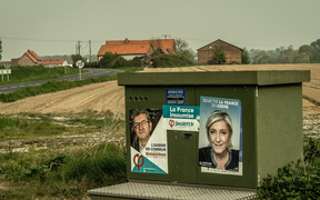 Campaign posters showing Marine Le Pen of the far-right Front National party (right) and for the far-left coalition La France Insoumise, Jean-Luc Mélenchon.
