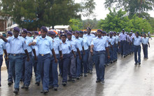 Papua New Guinea police officers marching in a parade