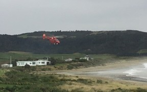A Westpac rescue helicopter comes in to land at Curio Bay