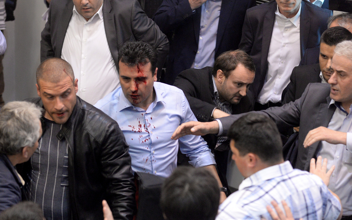 Opposition Social Democrats leader Zoran Zaev bleeds after being injured in the brawl.